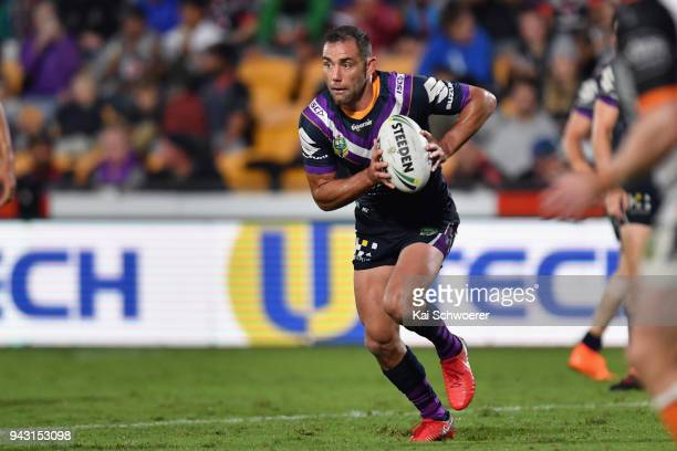 Cameron Smith of the Storm charges forward during the round five NRL match between the Wests Tigers and the Melbourne Storm at Mt Smart Stadium on...