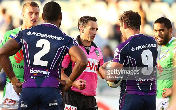 Cameron Smith of the Storm disputes a no try decision with referee Gerard Sutton during the round seven NRL match between the Canberra Raiders and...