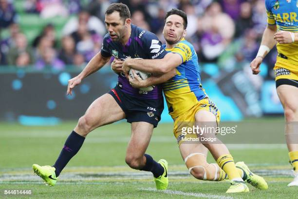 Cameron Smith of the Storm gets tackled by Corey Norman of the Eels during the NRL Qualifying Final match between the Melbourne Storm and the...