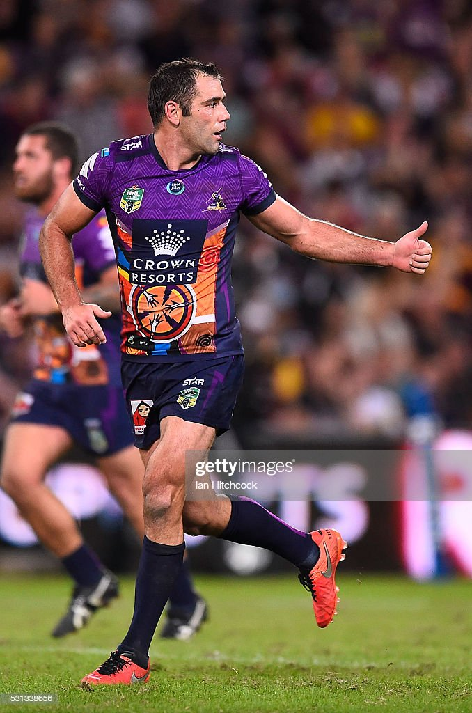 Cameron Smith of the Storm gives a thumbs up after kicking the winning field goal during the round 10 NRL match between the Melbourne Storm and the North Queensland Cowboys at Suncorp Stadium on May 14, 2016 in Brisbane, Australia.