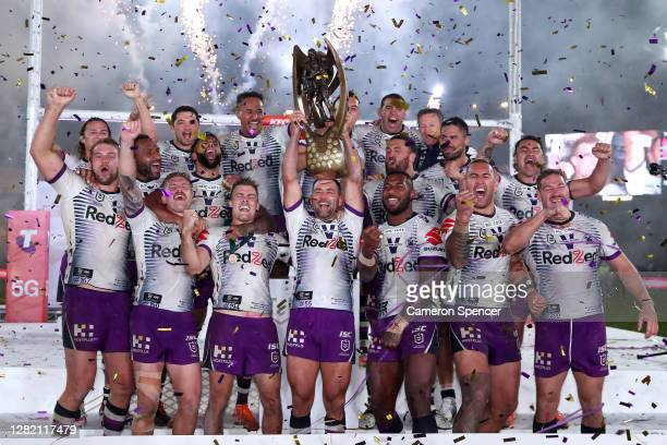 Cameron Smith of the Storm holds aloft the Premiership trophy and celebrates with team mates after winning the 2020 NRL Grand Final match between the...