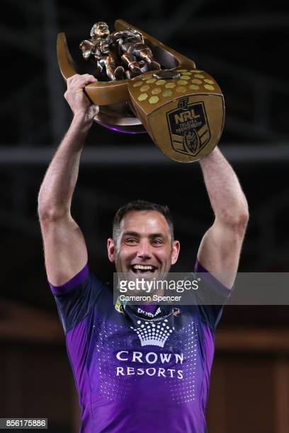 Cameron Smith of the Storm holds aloft the Provan-Summons Trophy after winning the 2017 NRL Grand Final match between the Melbourne Storm and the...