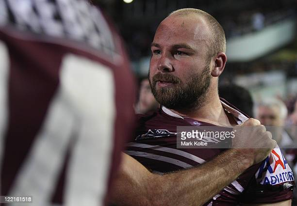 Cameron Smith of the Storm holds back Glenn Stewart of the Eagles during a fight during the round 25 NRL match between Manly Sea Eagles and the...