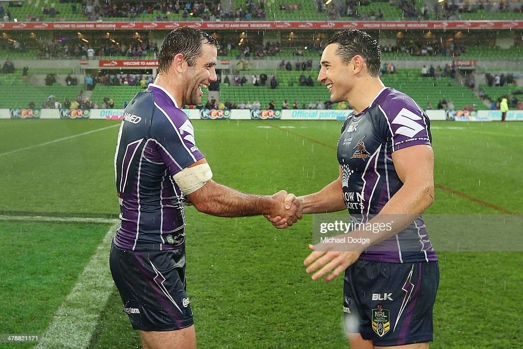 Cameron Smith of the Storm (L) in his club record 263rd game and Billy Slater in his 250th game celebrate their win during the round two NRL match between the Melbourne Storm and the Penrith Panthers at AAMI Park on March 15, 2014 in Melbourne, Australia.