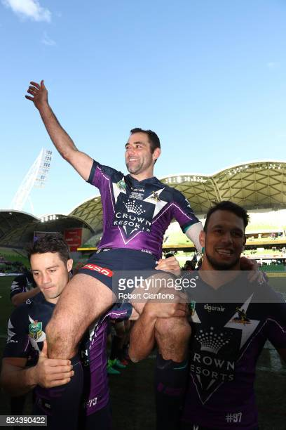 Cameron Smith of the Storm is carried off the ground after he played his 350th match during the round 21 NRL match between the Melbourne Storm and...