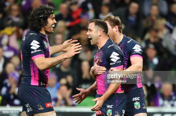 Cameron Smith of the Storm is congratulated by his teammates after scoring a try during the round 25 NRL match between the Melbourne Storm and the...