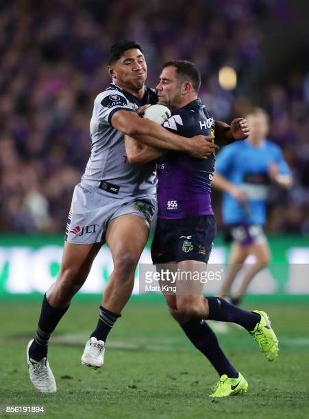 Cameron Smith of the Storm is tackled by Jason Taumalolo of the Cowboys during the 2017 NRL Grand Final match between the Melbourne Storm and the...
