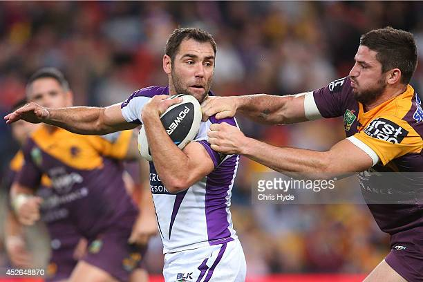 Cameron Smith of the Storm is tackled by Matt Gillett of the Broncos during the round 20 NRL match between the Brisbane Broncos and the Melbourne...