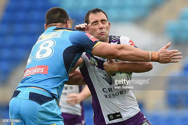 Cameron Smith of the Storm is tackled during the round nine NRL match between the Gold Coast Titans and the Melbourne Storm on May 1 2016 in Gold...