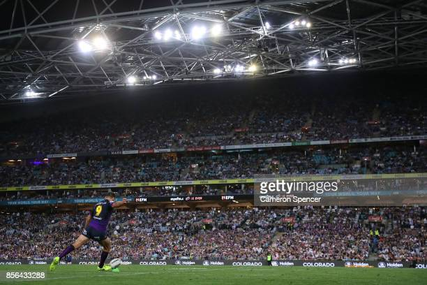 Cameron Smith of the Storm kicks during the 2017 NRL Grand Final match between the Melbourne Storm and the North Queensland Cowboys at ANZ Stadium on...