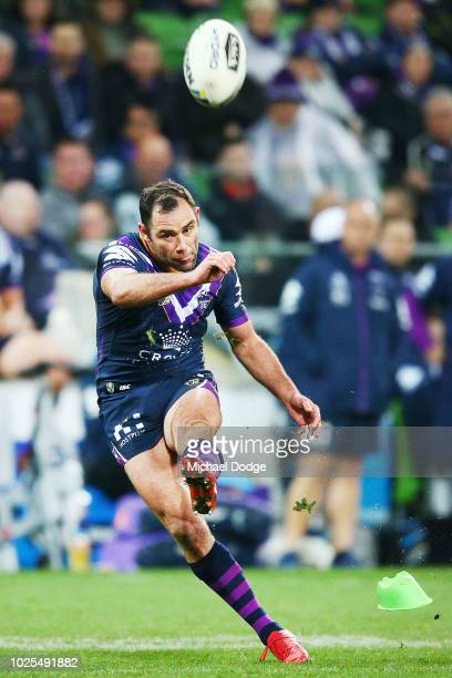 Cameron Smith of the Storm kicks the ball but misses a goal during the round 25 NRL match between the Melbourne Storm and the Penrith Panthers at...