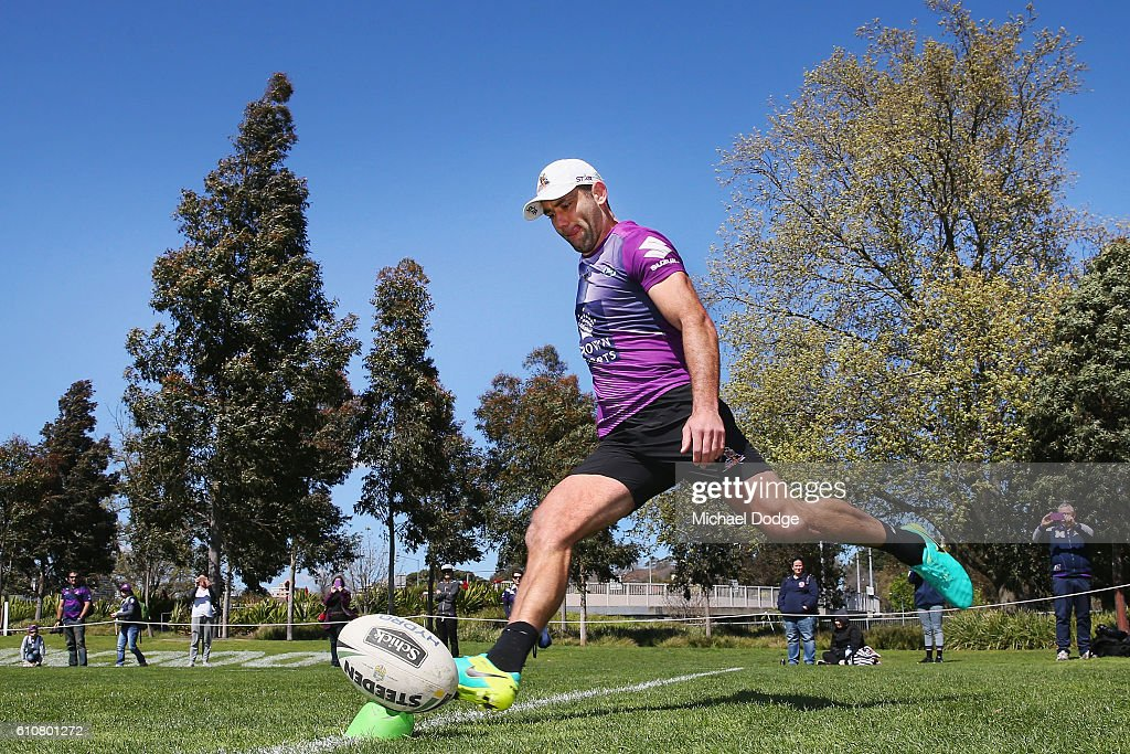 Cameron Smith of the Storm kicks the ball during a Melbourne Storm NRL training session at AAMI Park on September 28, 2016 in Melbourne, Australia.