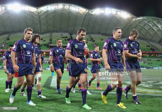 Cameron Smith of the Storm leads his team from the field after losing the round eight NRL match between the Melbourne Storm and the Canberra Raiders...