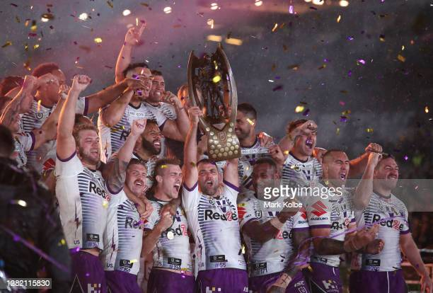 Cameron Smith of the Storm lifts the Premiership Trophy during the 2020 NRL Grand Final match between the Penrith Panthers and the Melbourne Storm at...