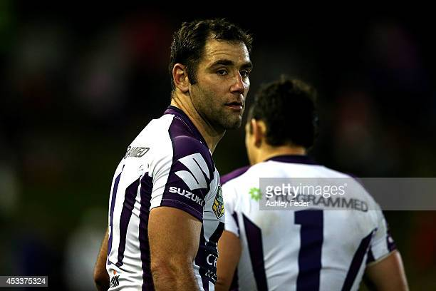 Cameron Smith of the Storm looking dejected after losing to the Knights during the round 22 NRL match between the Newcastle Knights and the Melbourne...