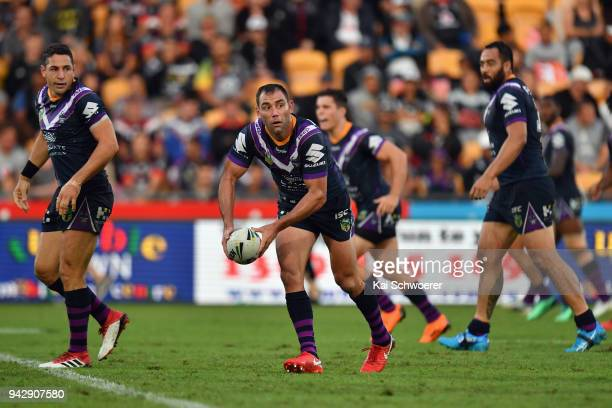 Cameron Smith of the Storm looks to pass the ball during the round five NRL match between the Wests Tigers and the Melbourne Storm at Mt Smart...