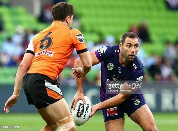 Cameron Smith of the Storm offloads during the round 16 NRL match between the Melbourne Storm and Wests Tigers at AAMI Park on June 26 2016 in...