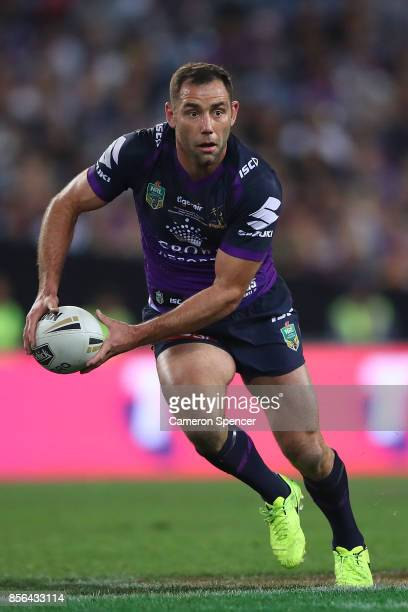 Cameron Smith of the Storm offloads the ball during the 2017 NRL Grand Final match between the Melbourne Storm and the North Queensland Cowboys at...