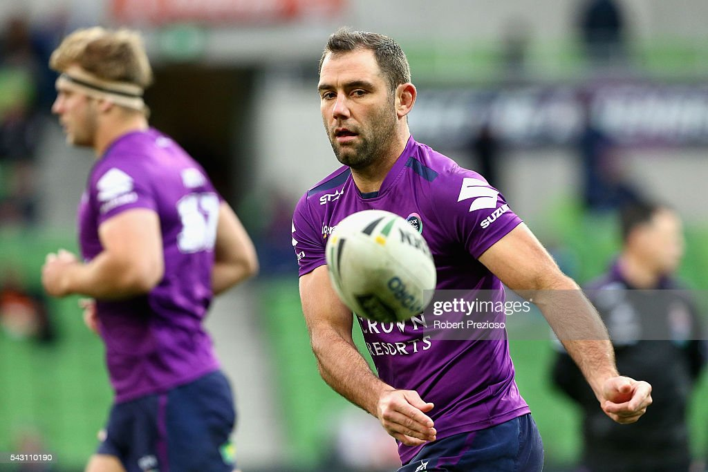 Cameron Smith of the Storm offloads the ball during warm up prior to the round 16 NRL match between the Melbourne Storm and Wests Tigers at AAMI Park on June 26, 2016 in Melbourne, Australia.