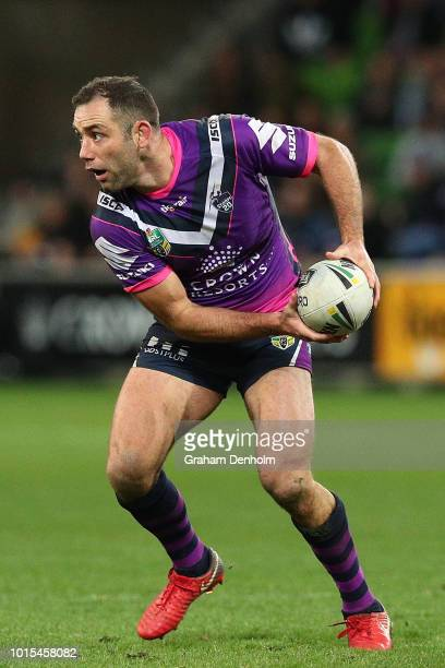 Cameron Smith of the Storm passes during the round 22 NRL match between the Melbourne Storm and the Cronulla Sharks at AAMI Park on August 12 2018 in...