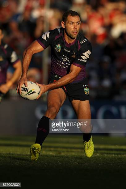 Cameron Smith of the Storm passes during the round nine NRL match between the St George Illawarra Dragons and the Melbourne Storm at WIN Stadium on...