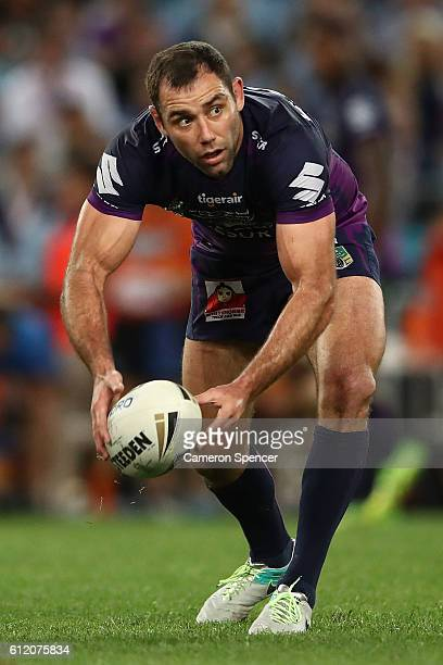 Cameron Smith of the Storm passes the ball during the 2016 NRL Grand Final match between the Cronulla Sharks and the Melbourne Storm at ANZ Stadium...