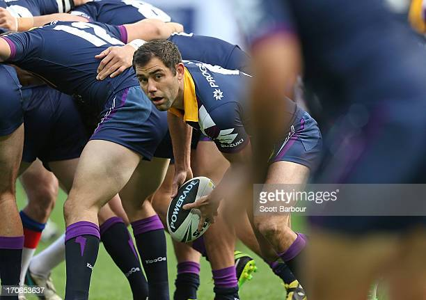Cameron Smith of the Storm passes the ball during the round 14 NRL match between the Melbourne Storm and the Newcastle Knights at AAMI Park on June...