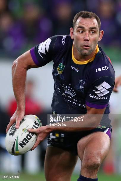 Cameron Smith of the Storm passes the ball during the round 17 NRL match between the Melbourne Storm and the St George Illawarra Dragons at AAMI Park...