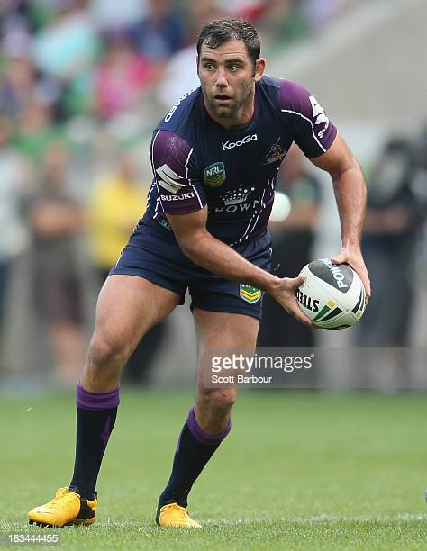 Cameron Smith of the Storm passes the ball during the round one NRL match between the Melbourne Storm and the St George Illawarra Dragons at AAMI...