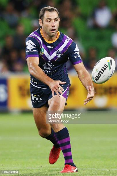 Cameron Smith of the Storm passes the ball during the round three NRL match between the Melbourne Storm and the North Queensland Cowboys at AAMI Park...