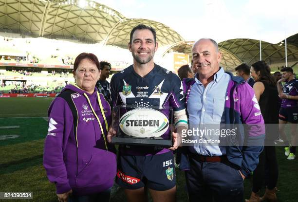 Cameron Smith of the Storm poses with his mother Sonia and father Wayne after he played his 350th match during the round 21 NRL match between the...