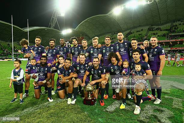 Cameron Smith of the Storm poses with teammates and the trophy after a win during the round eight NRL match between the Melbourne Storm and the New...