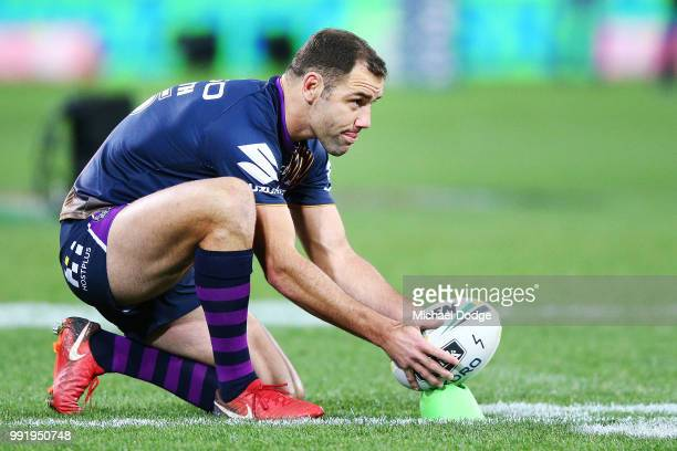 Cameron Smith of the Storm prepares to kick the ball in the warm up during the round 17 NRL match between the Melbourne Storm and the St George...