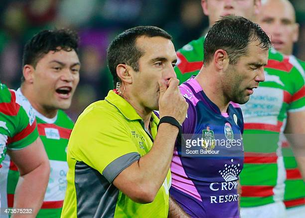 Cameron Smith of the Storm reacts as Issac Luke of the Rabbitohs looks on shortly after Smith kicked Luke in a tackle as referee Matt Cecchin blows...