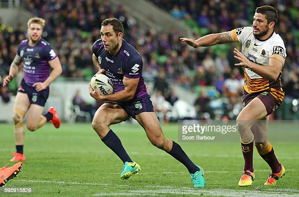 Cameron Smith of the Storm runs in to score a try during the round 25 NRL match between the Melbourne Storm and the Brisbane Broncos at AAMI Park on...