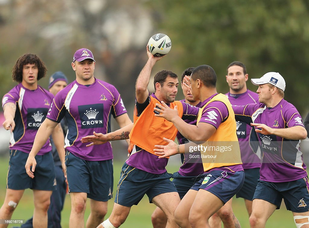 Cameron Smith of the Storm runs with the ball during a Melbourne Storm NRL training session at Gosch's Paddock on May 22, 2013 in Melbourne, Australia.
