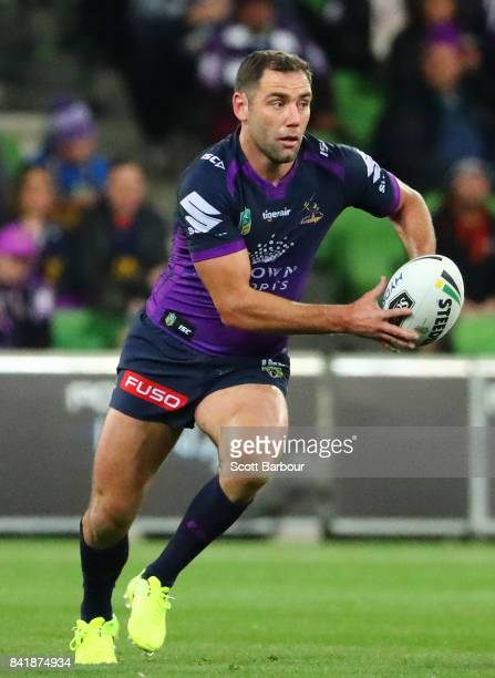 Cameron Smith of the Storm runs with the ball during the round 26 NRL match between the Melbourne Storm and the Canberra Raiders at AAMI Park on...