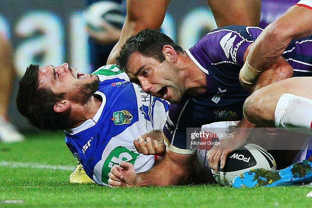 Cameron Smith (R) of the Storm scores a try during the round three NRL match between the Melbourne Storm and the Newcastle Knights at AAMI Park on March 24, 2014 in Melbourne, Australia.