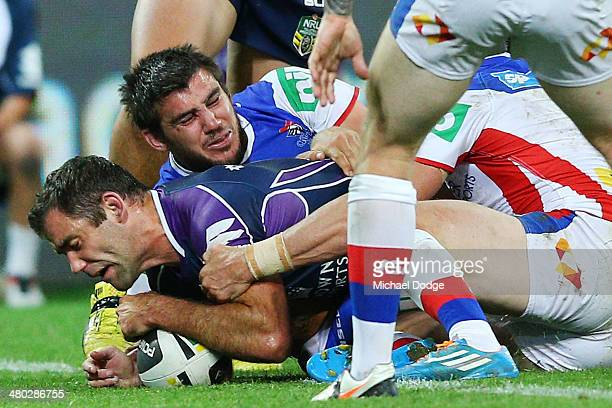 Cameron Smith of the Storm scores a try during the round three NRL match between the Melbourne Storm and the Newcastle Knights at AAMI Park on March...