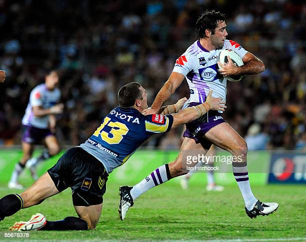 Cameron Smith of the Storm skips out of a tackle of Luke O'Donnell of the Cowboys during the round three NRL match between the North Queensland...