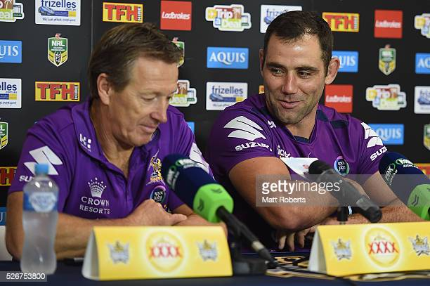 Cameron Smith of the Storm speaks during a press conference with coach Craig Bellamy after the round nine NRL match between the Gold Coast Titans and...