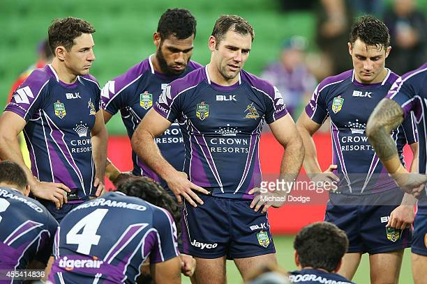 Cameron Smith of the Storm speaks to teamates after their defeat during the NRL 2nd Elimination Final match between the Melbourne Storm and the...