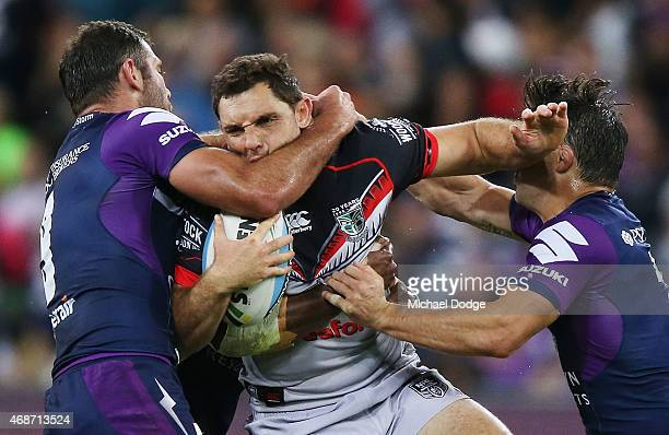 Cameron Smith of the Storm tackles Jonathan Wright of the Warriors during the round five NRL match between the Melbourne Storm and the New Zealand...