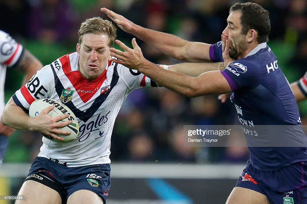 Cameron Smith of the Storm tackles Mitchell Aubusson of the Roosters during the round 20 NRL match between the Melbourne Storm and the Sydney Roosters at AAMI Park on July 23, 2016 in Melbourne, Australia.