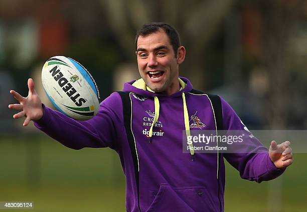 Cameron Smith of the Storm takes the ball during a Melbourne Storm media session at Gosch's Paddock on August 6 2015 in Melbourne Australia