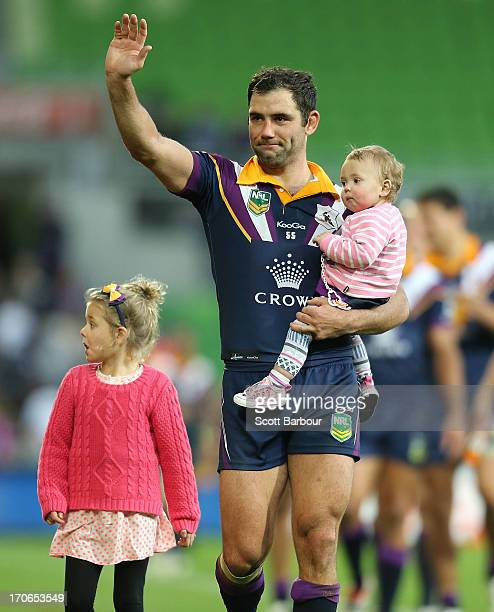 Cameron Smith of the Storm thanks the crowd with his children after the round 14 NRL match between the Melbourne Storm and the Newcastle Knights at...