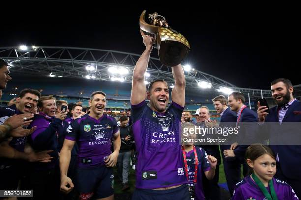 Cameron Smith of the Storm walks off the field with team mates Billy Slater and Cooper Cronk during the 2017 NRL Grand Final match between the...