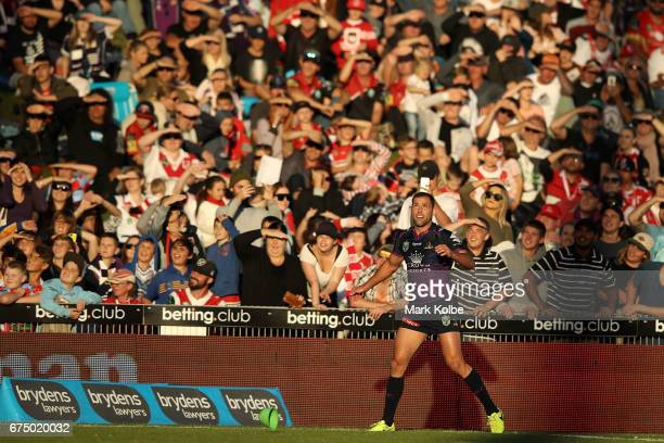 Cameron Smith of the Storm watches the ball after kicking for goal from the sideline during the round nine NRL match between the St George Illawarra...