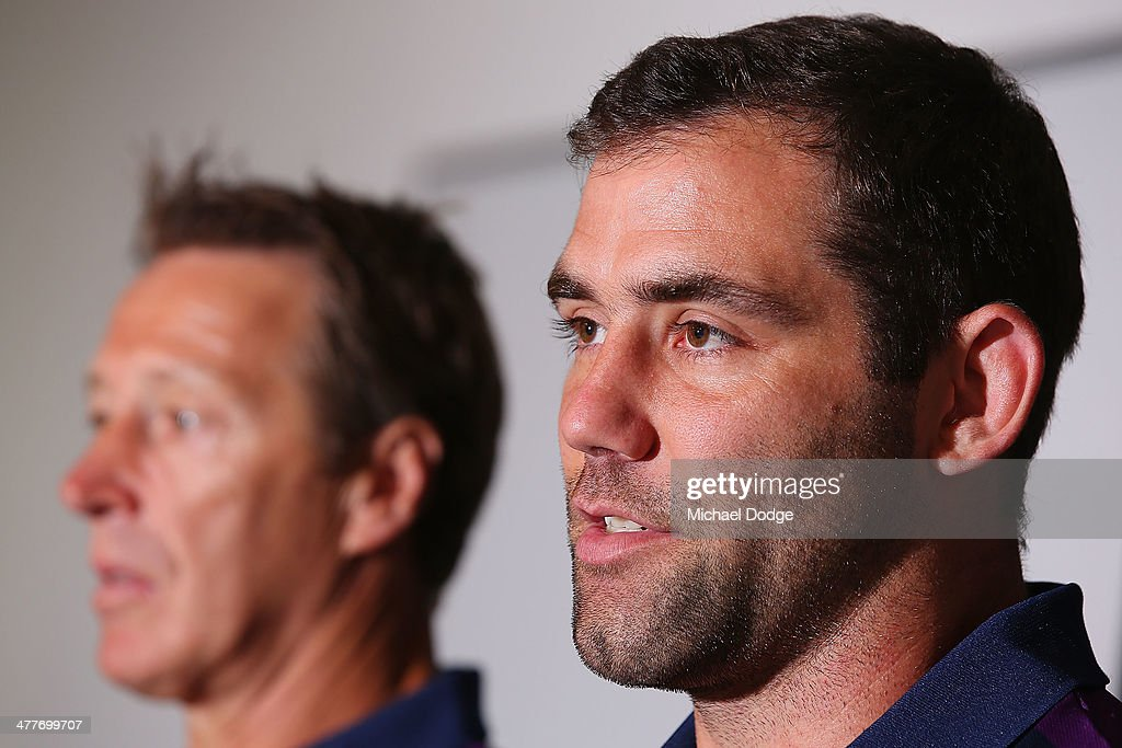 Cameron Smith (R) of the Storm, who has signed a four year contract extension and breaks the game record for a Storm player this weekend, speaks to media with coach Craig Bellamy during a Melbourne Storm NRL media session at AAMI Park on March 11, 2014 in Melbourne, Australia.