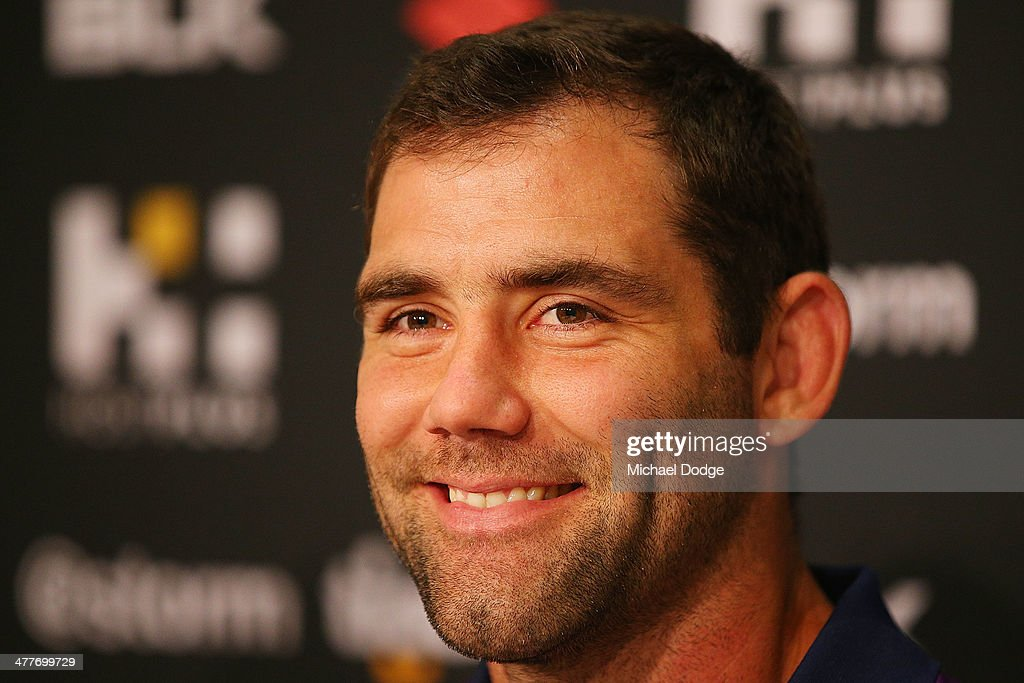 Cameron Smith of the Storm, who has signed a four year contract extension and breaks the game record for a Storm player this weekend, reacts during a Melbourne Storm NRL media session at AAMI Park on March 11, 2014 in Melbourne, Australia.